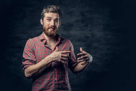 haircut: A positive bearded male dressed in a red fleece shirt tells a story with hand movement.