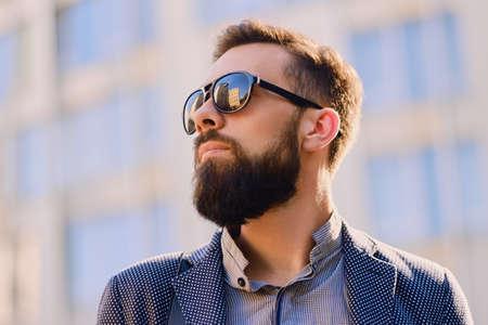 Portrait of bearded male in sunglasses.