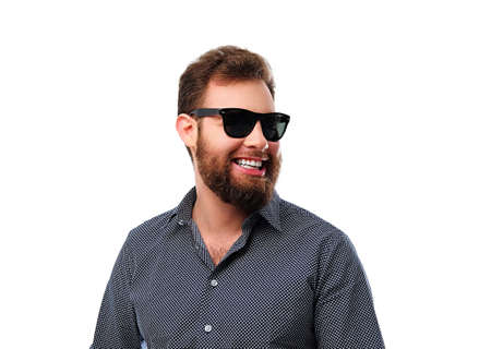 Smiling redhead bearded male in sunglasses isolated on white background. Reklamní fotografie