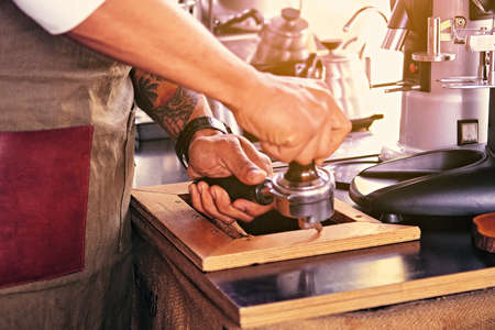 A man pouring coffee in a restaurant.