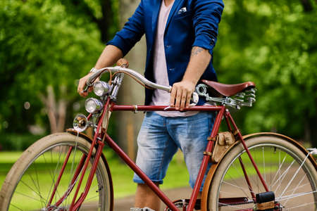 throttle: Close up image of a man on a retro bicycle. Stock Photo