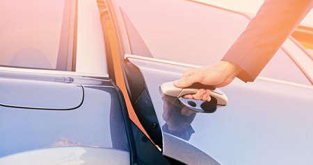 Close up image of a man opens car's door. Stockfoto