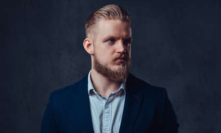Portrait of stylish blond bearded male dressed in a suit. Reklamní fotografie