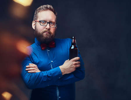 A man drinks craft beer from a bottle. Stock Photo
