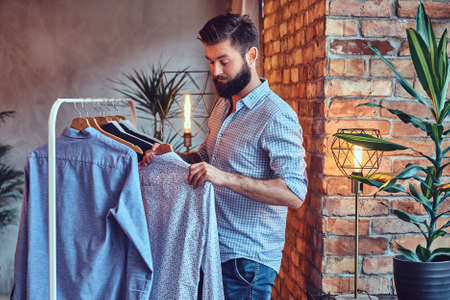 A man fit on fashionable shirts. Stock Photo