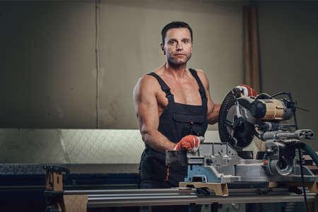 A man works with circular saw. Stok Fotoğraf