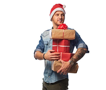 A man holds Christmas gifts.
