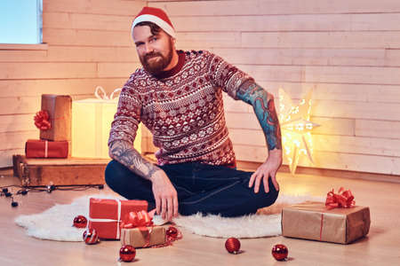 A man in a room with Christmas decoration. Stock Photo