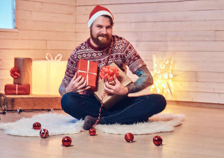 A man in a room with Christmas decoration. Reklamní fotografie
