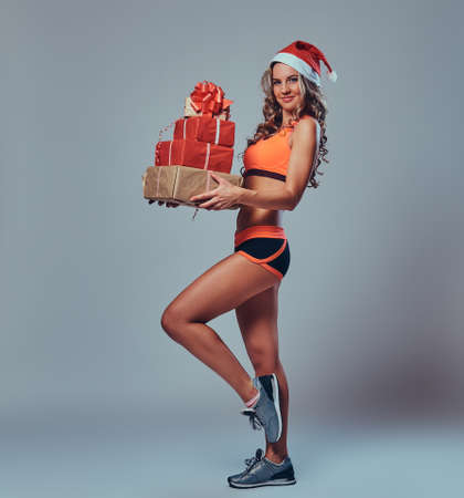 Female holds Christmas gifts. Stock Photo
