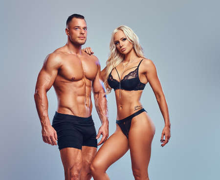 Studio portrait of attractive fitness couple. 스톡 콘텐츠