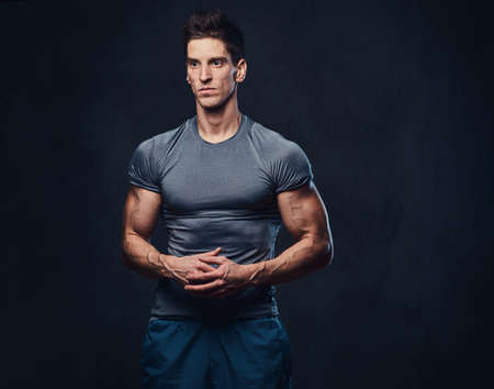 Athletic male dressed in a grey sportswear. Stock Photo