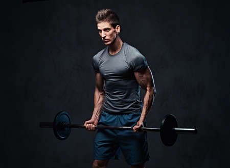 Athletic male biceps barbell workout.