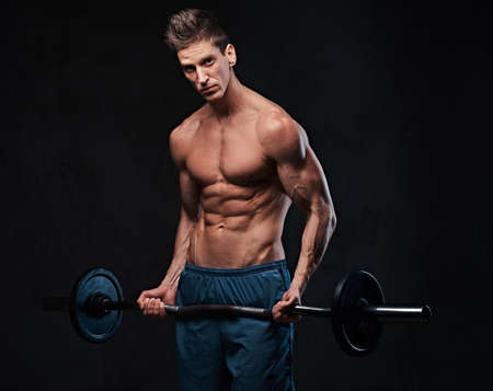 Athletic shirtless male biceps barbell workout. Stock Photo