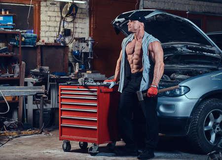 A man in a garage. Stok Fotoğraf