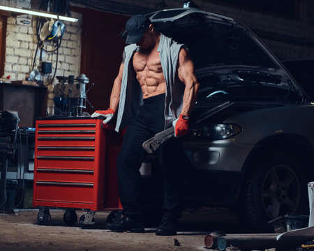 A man in a garage. Stock Photo
