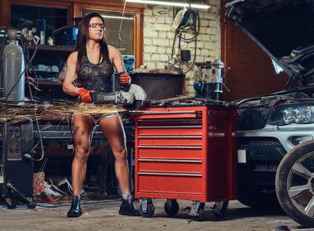 A woman holds hand saw. Reklamní fotografie