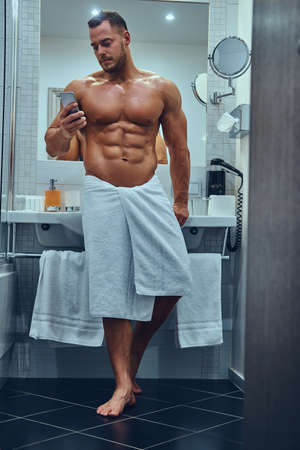 A handsome muscular male in stylish twin bathroom.