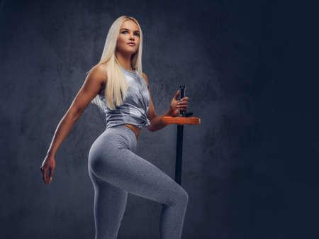 Studio portrait of a sporty woman.
