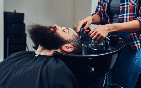 Handsome bearded man in the barbershop. 스톡 콘텐츠