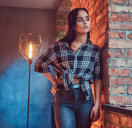 Portrait of an attractive brunette dressed in flannel shirt