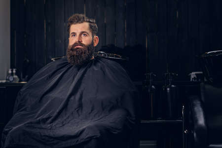 Handsome bearded man in the barbershop. Stock Photo