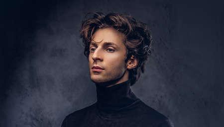 Portrait of a charismatic sensual male in black sweater. Creative