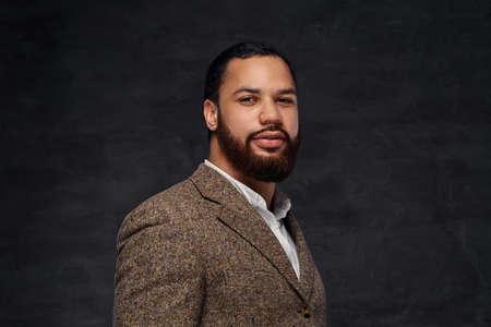 Handsome bearded African-American businessman in a brown classic jacket. Stock Photo