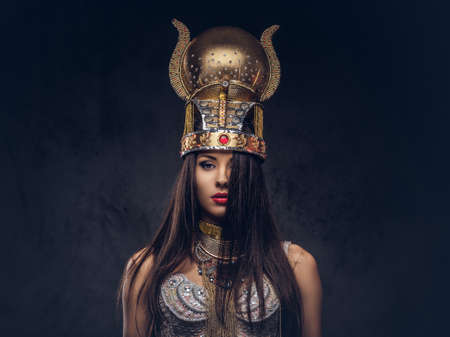 Portrait of haughty Egyptian queen in an ancient pharaoh costume. 免版税图像