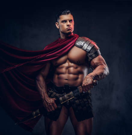 Brutal ancient Greece warrior with a muscular body in battle uniforms Stock Photo