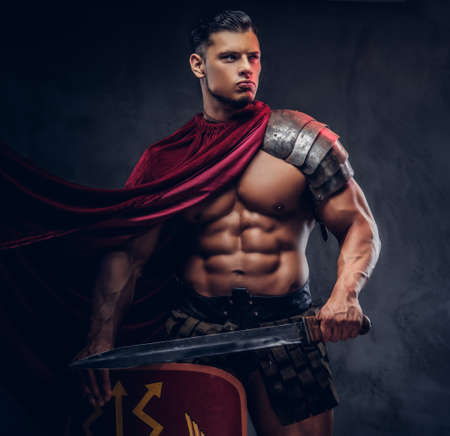 Brutal ancient Greece warrior with a muscular body in battle uniforms Banco de Imagens
