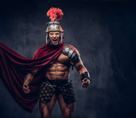 Brutal ancient Greece warrior with a muscular body in battle uniforms screams in battle agony