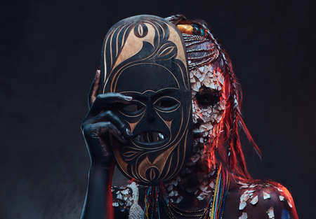 Close-up portrait of an African shaman female from the indigenous African tribe, wearing traditional costume. Make-up concept. Stock Photo