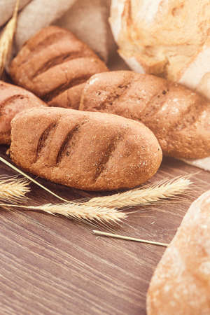 Delicious freshly bakery products on wooden background.