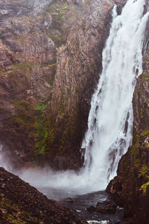 Waterfall in rocky mountains. Amazing nature in Norway. fjord in Norway. 免版税图像
