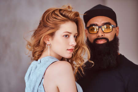 Portrait of an Arabian bearded male and beautiful redhead girl. Banco de Imagens
