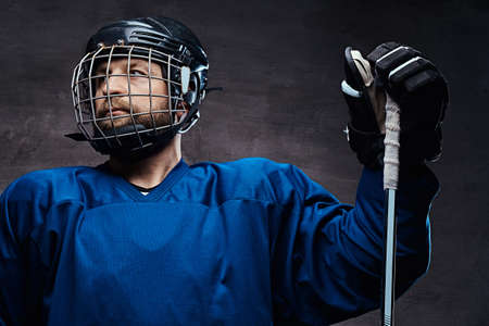 Portrait of a professional ice-hockey player in a hockey uniform.