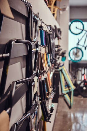 Vertical photo of a specialized store of spare parts for BMX bikes. Active lifestyle concept