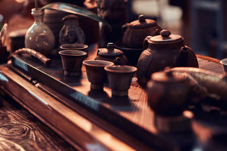 Set of accessories, ceramic cups and teapots all for making a natural delicious aromatic tea. Traditional Asian tea ceremony