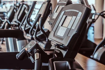 Closeup photo shoot of empty treadmills in gym. Stock Photo