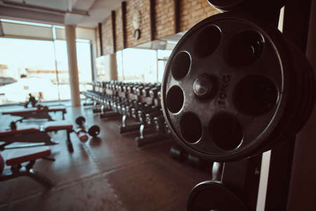 Photo of sport equipment in trendy sunny gym. Stock Photo