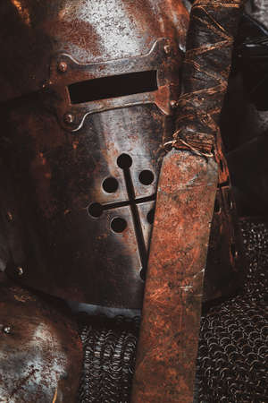 Photo of rusted sword, helmes and chain mail. Studio photo shoot. Stock Photo