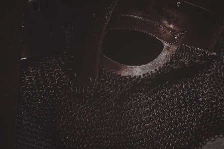 Closeup photo of ancient helmet with chain mail.