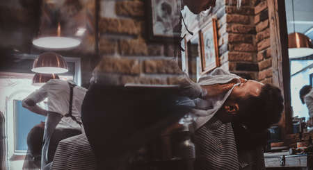Attractive relaxed man just got great service from talanted trendy barber. 写真素材 - 124964696