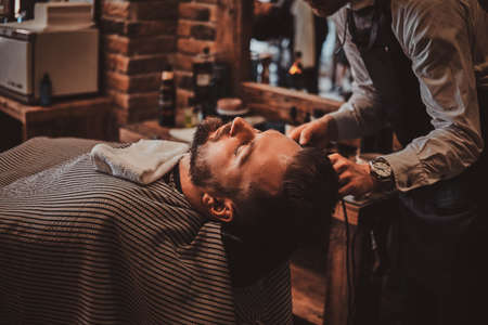 Attractive brutal man just got good beardcare from talanted trendy barber. 写真素材 - 124965338