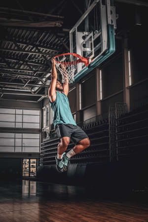 Black professional Black basketball player in action in a basketball court.