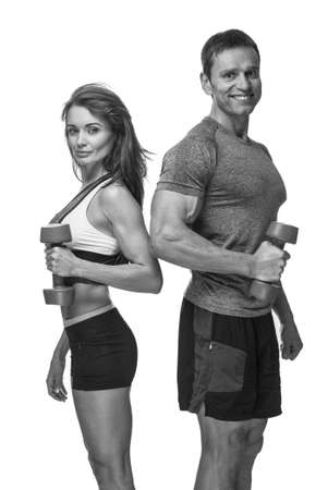 Sporty couple with dumbbells isolated on a white background.