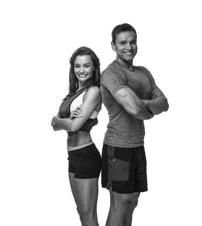 Smiling sporty couple isolated on a white background.