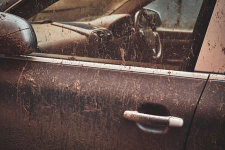 Closeup photo shoot of dirty cars door and window, splash of mud on silver car.