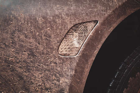 Close-up image of a dirty car after a trip off-road. Front fender. Stock Photo